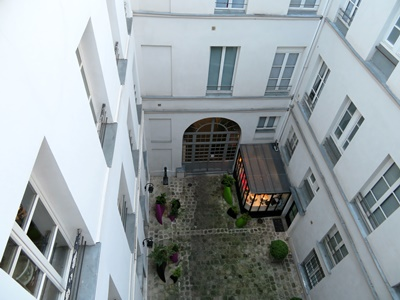 View from apartment balcony of courtyard