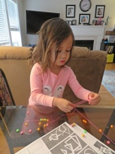 Caitlyn concentrating on beading