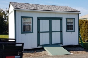 Front of shed with ramp for riding lawn mower