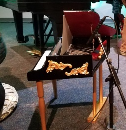 Toy piano, which Jennifer Wright played while sitting on a cushion