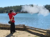 Firing a musket at English Camp on San Juan Island