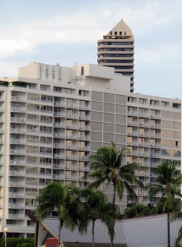 The tall, skinny building is the Marina Tower Waikiki